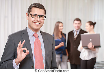 Businessman with a team at the meeting - Great job. Young...