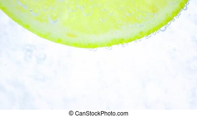 sparkling with bubbles and lime - sparkling water in the...