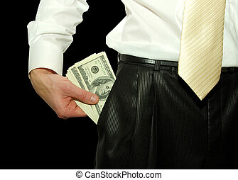money in pockets - a man holds money in pockets
