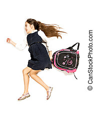 cute schoolgirl being late and running to school with...