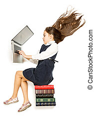?ute schoolgirl sitting on books and using laptop - Isolated...