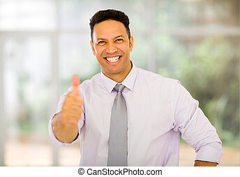 mature business man giving thumb up - portrait of handsome...