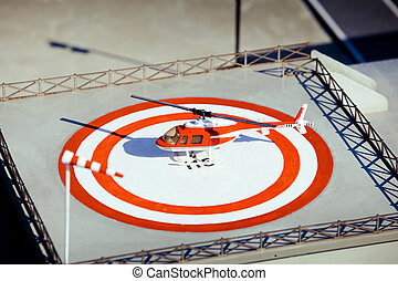 Helicopter on heliport - Helicopter is landing on heliport...
