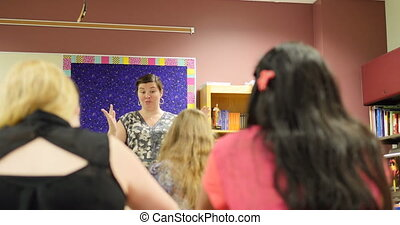 Student raising hand during teacher - A high school student...