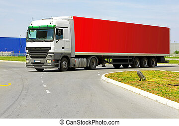 Red lorry - Side view of long red semi lorry