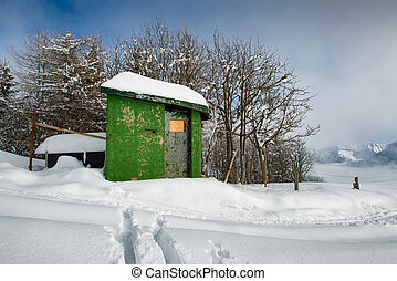 Hunting cabin in the snow