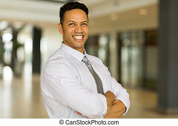 mid age office worker with arms crossed
