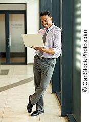 business man using laptop computer - modern business man...