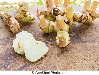 galangal - Galangal, cut into thin slices and place on a...