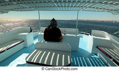 Captain Arab manages boat yacht sailing at high speed across...