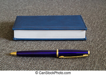 Note Pad and  Blue Pen.