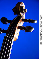 Violin Scroll Isolated on Blue