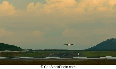 Landing - Jet airplane touch down the runway in dusk,...
