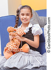 Girl with a soft toy - Happy childhood. Small smiling girl...