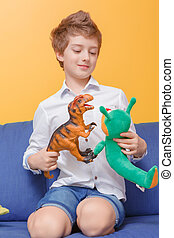 Boy plays with toys - Let kids play. Portrait of a nice...