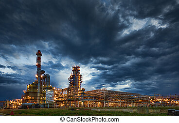 Oil Refinery At evening - big Oil and gas Refinery At...