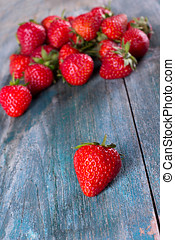 Fresh strawberries on the old board. - Fresh, ripe...