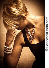 woman and jewelry - short hair blond elegant young woman...