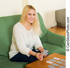 Housewife telling fortunes by cards - Relaxed happy...