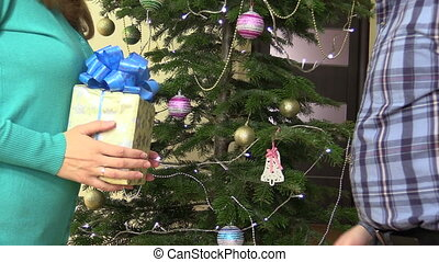 man woman christmas gift - Female woman give yellow present...