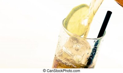 fresh cola with lime slice - pouring fresh coke with lime...