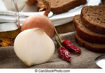Close up still life of bread, onion, pepper and other products