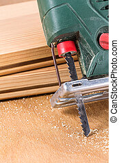 Jig saw closeup - Carpenters electric fret-saw tool on a...