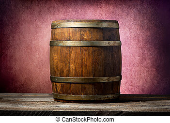 Barrel on pink background - Wooden barrel on a table and...