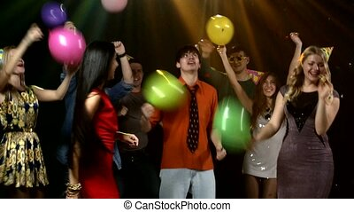 Friends dancing the nightclub fray streamers and they throw...