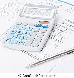 Neat calculator with silver pen and utility bill under it -...