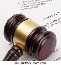 Wooden judge's gavel and contract - close up shot