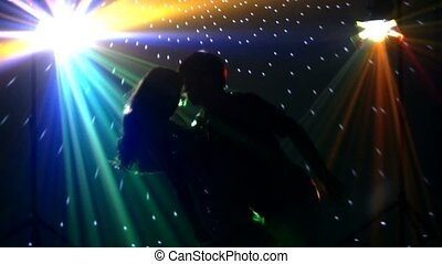 pair dancers dancing in spotlight at the club, silhouette -...