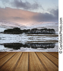 Forest and mountain Winter landscape reflected in calm lake with
