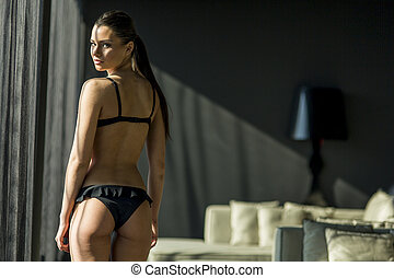 Young woman in the room - Young woman in underwear in the...