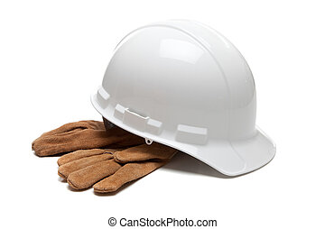 White hard hat and leather work gloves on white - A white...