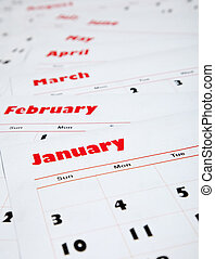 stack of monthly calendars - A stack of monthly calendars...