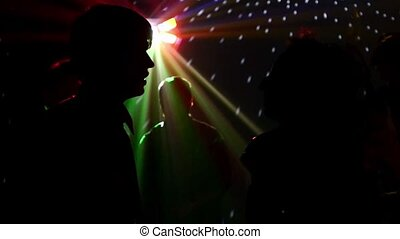 pair dancers dancing in spotlight at the club, silhouette,...
