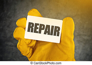 Repair on Business Card, Male Hand in Yellow Leather...