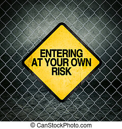Entering at Your Own Risk Grunge Yellow Warning Sign on...
