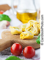 Tortellini - Homemade raw Italian tortellini and basil...
