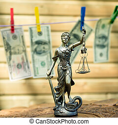 money laundering concept: image of Themis goddess or lady...