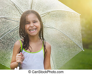 Little girl under umbrella in rainy day