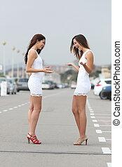 Happy women wearing the same dress - Happy fashion women...