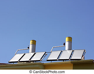 Solar water heating panels on a house roof