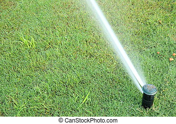 automatic watering system on green grass