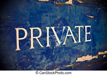 Private - Peeling paint on a door with the word private...