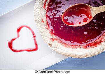 Jam. - Raspberry jam spoon. Studio photography.