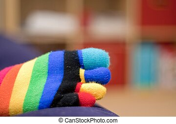 Happy feet - Five-toed rainbow sock on a foot