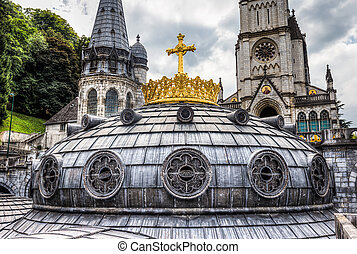 The gilded crown and cross surmounting the dome on the Upper...