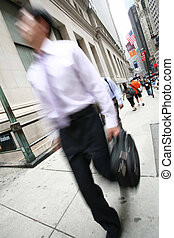 businessmen walking on the street in motion blur